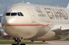 Manchester Airport: Etihad Airbus A330 about to take off from runway