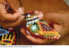 Huichol artist at work. The detail is so fine and precise.