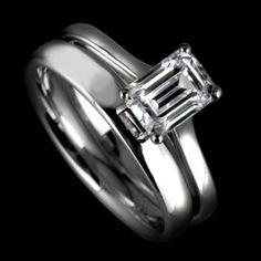 Emerald cut engagement ring and matching wedding ring by www.diamondsandrings.co.uk