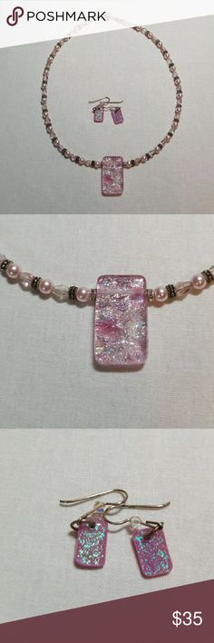Pink Dichroic  necklace and earrings This is a lovely necklace with a pink dichroic glass pendant strong on pearls and pink beads. It has matching earrings as well. Jewelry