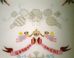 Wedding Sampler. Cross stitch and pulled thread work on 18-count Aida evenweave fabric. Detail.