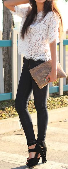 Gorgeous top white short sleeve blouse with black casual jeans and khaki leather cute hand bag and awesome black high heels ladies pumps