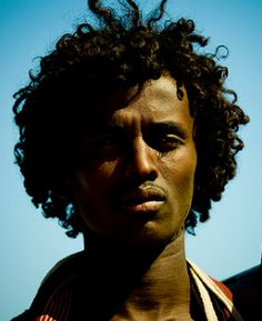 Afar man with a curly afro, a hairstyle having ancestry in dynastic Egypt. Somalia.