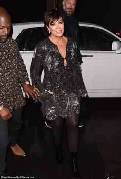 And momager Kris is here too! The girls' mother Kris Jenner and her boyfriend Corey Gamble...