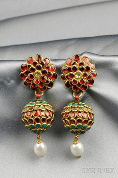 Diamond, Enamel, and Peal Earpendants, India, each with various colored enamels and rose-cut diamond accents, suspending a pearl, gilt-silver mounts, lg. 2 1/2 in.
