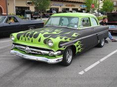 Lime Green flames over flat black. Darrell Angre drives this '54 Ford sedan around the Ormond Beach, FL area.