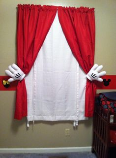 Mickey Mouse curtains. Simply use plain red and white curtains and metal curtain pull backs. We also used large rubber bands to hold the curtains in place. Then place Mickey Mouse gloves over the pull backs and voila! Perfect for a nursery.