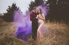 Gender reveal photo with smoke bomb