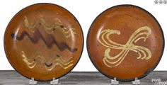 "Pook & Pook 1/16/16 Lot: 428.  Estimated: $400 - $600.  Realized Price: $510.  Description: Two Pennsylvania slip decorated redware pie plates, 19th c., 8 1/4'' dia. and 8 1/2'' dia. Provenance: The collection of Jeanne and Bernard B. Hillmann, Wyckoff, New Jersey.  Condition: Small - old 1 1/2"" rim chip. Large - a few old rim chips, some wear to surface."