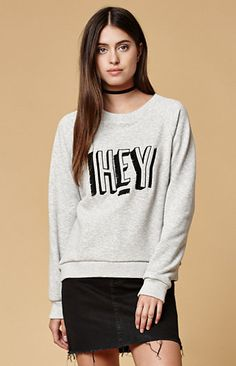 The Hey There Embroidered Crew Neck Sweatshirt is far from ordinary. It features long raglan sleeves, and an embroidered graphic on front with fringe detailing, and incredibly soft fleece lining. Put on this MinkPink crew neck sweatshirt with skinny jeans and ankle boots.   Long raglan sleeves Ribbed neck, cuffs and hem Super soft fleece lining Embroidered, fringed graphic on front Model is wearing a small        Model's measurements: Height: 5'8'' Bust: 34'' Waist: 26'' Hips: 34'' 50%…