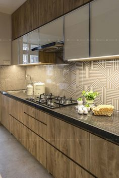 A simple 2 Bedroom apartment in the hustle bustle of Mumbai Suburbs has been designed as a perfect pause moment. Kitchen Cupboard Designs, Kitchen Room Design, Home Room Design, Home Decor Kitchen, Interior Design Kitchen, Moduler Kitchen, Lemon Kitchen, Bedroom Cupboard Designs, Modern Kitchen Cabinets