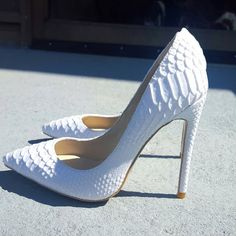 @Taviapshoes New White Python Heels though!!! The perfect pump!!!