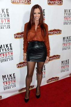 Jessica Sutta Leather Dress - Jessica Sutta attended the opening night of 'Mike Tyson: Undisputed Truth' wearing a short leather skirt and a silk top. Sexy Blouse, Blouse And Skirt, Jessica Sutta, Fishnet Leggings, Tights, Black Leather Mini Skirt, Leather Skirts, Leather Boots, Pantyhose Outfits
