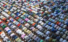 Indian Muslims offer prayers on Eid al-Adha at the Kharudin Mosque in Amritsar…