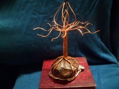 """This is a Copper FlameTree of Life sculpture based on a Mahogany Obsidian Piece with Aluminum wire base, the tree is approx. 6-7 inches tall, 5 inches long and 5 inches wide, The stone base is approx. 3""""x2""""x1"""" (LXWXH). Shipping is Parcel post through USPS. Pick up Option is available only to those living in Oregon! Please contact our shop if you are able to pick this item up locally to waive shipping fees."""