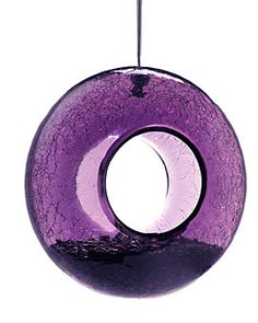 Glass Feeder, purple - Your backyard bird friends will love this versatile feeder. In nice weather they can rest on the rim of the feeder and enjoy a nice treat. When its wet or windy the birds can hop inside to stay dry and eat. The crackle glass sparkles when it catches in the light. This feeder also features drainage holes to keep seeds dry.
