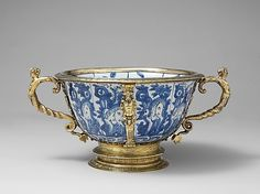 Two-handled bowl (part of a set)  Date:     Porcelain 1573–1620; mounts ca. 1585 Culture:     Chinese with British (London) mounts Medium:     Hard-paste porcelain, silver gilt