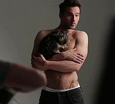 brett dalton shirtless cuddling a puppy...what more does a girl need?