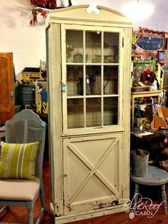 A salvaged cabinet door now proudly fronts a DIY cabinet.
