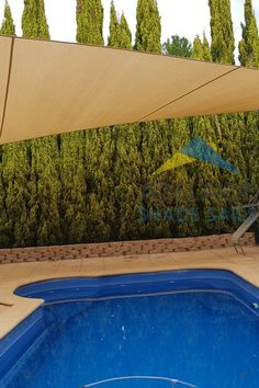 A stylish pool shade sail from the Rainbow Shade Z16 range in the colour Desert Sand. This custom made sail protects the pool and surrounding area from the harsh Australian Sun with 97% UVR and 89% shade. Perfect for a Friday afternoon by the pool so you can enjoy a cool drink in the shade.