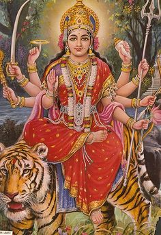 """Goddess Durga. Sanskrit: """"the inaccessible"""", Bengali: দুর্গা) is a form of Devi, the supreme goddess. In Bengal, she is said to be the mother of Ganesha, Kartikeya as well of Saraswati and Lakshmi. Durga is depicted as a warrior woman riding a lion or a tiger with multiple hands carrying weapons and assuming mudras, or symbolic hand gestures. This form of the Goddess is the embodiment of feminine and creative energy"""
