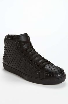bfc88e1ca0c Toothy rubber studs add a touch of danger to a retro high-top sneaker in a  monochrome cast.Leather upper and lining rubber sole.By Gucci