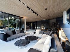 Stylish living room design with beautiful glass coffee tables and modern, white sofa in a luxurious villa located in Vienna, Austria