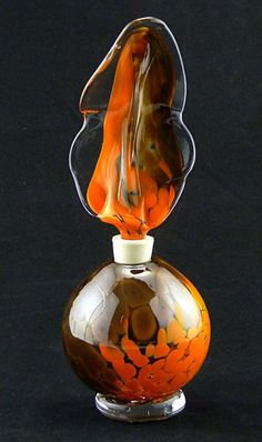 Topped with a glass feather bottle stopper, the perfume bottle stays air tight and is great for continued use over time. Description from riverwood-glass-gallery.myshopify.com. I searched for this on bing.com/images