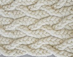 Experimental knit sample with braided textures; structural knitting; textiles design // Emma Brooks