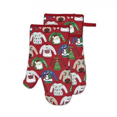 Easily maneuver around the kitchen protected, but in festive style with the Harman Christmas Diva Cotton Oven Mitts finished in white with red 'Ugly Sweater' appointments. These cotton mitts provide sufficient heat protection when dealing with hot dishes, but still quite form-fitting and not oversized. Stay unscathed with these machine-washable & totally fun oven mitts!