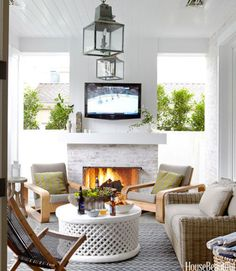 "Designers Parrish Chilcoat and Joe Lucas's client loves to entertain, so they set up the open-air loggia in a California house, with a fireplace, a flat-screen TV and overhead heat lamps, ""so he can use it all year."" The loggia is furnished with a Provence love seat in synthetic wicker and St. Barts teak lounge chairs — all from Restoration Hardware — an Ikea Brommö deck chair, a white-painted African table from Berbere World Imports and Brantley lanterns from Circa Lighting. Click through…"