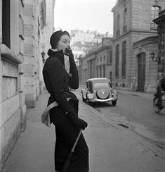 Jaques Fath's coat dress with blown-back peplum. Paris, 1949.