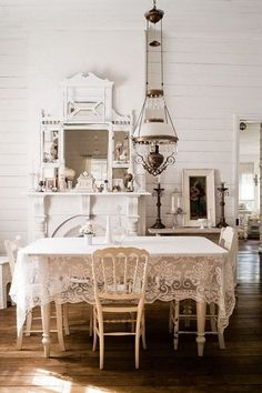 Shabby Chic Dining Room with Lace Table Cloth and Vintage Crystal Chandelier. #shabbychickitchentable