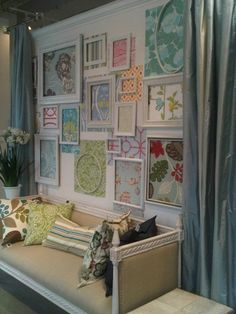frame wall - visual merchandising   made this to display wallpaper & fabric  What a good idea!