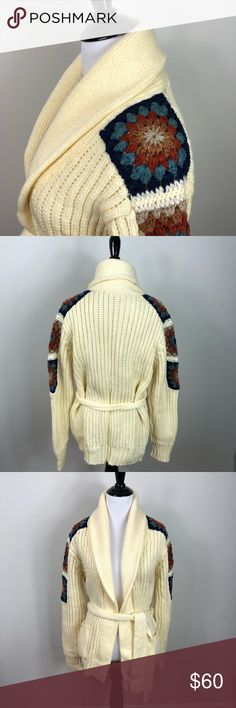 """Vintage Kennington Shawl Collar Crochet Cardigan How cool is this vintage 70s sweater? Even the tag is unique! 100% Acrylic. Tie belt waist. Cream color with multi color crochet detail on shoulders. Oversized fit. Great condition. Size Medium  19"""" across at bust  27"""" long Vintage Sweaters Cardigans"""