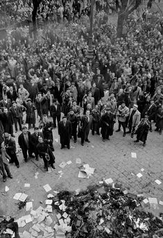 """The 1956 Hungarian Revolution – in pictures """"Among the few buildings looted after the battle were the 'cultural centres' of the Communist party. Lots of books and photographs were thrown or carried out to bonfires in streets"""" Border Guard, Warsaw Pact, Crop Circles, Cultural Center, Life Magazine, Cold War, World History, The Guardian, Ancestry"""
