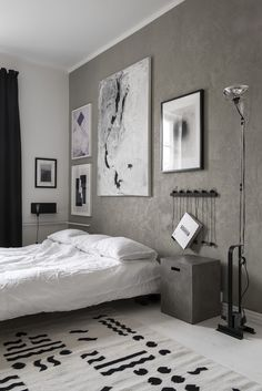 Monochrome bedroom in the Finnish home of a composer  / design by Laura Seppänen.