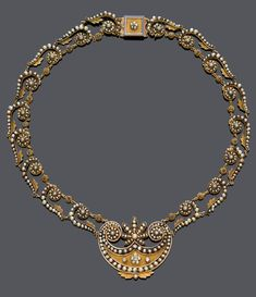 AN ANTIQUE PEARL AND DIAMOND NECKLACE, CIRCA 1810. Empire necklace with rosette-, scroll- and leaf motifs, set with small natural pearls, the matt-finished centre with involute endings and palmette-motif, set with natural pearls and 8 rose-cut diamonds, mounted in yellow gold. #antique #necklace