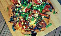 A delicious cross between a simple caprese salad and traditional bruschetta in pizza form! Makes 2 Ingredients: 1 clove garlic, peeled and cut in half 2 flatbreads or naan bread 2 Roma (plum) tomatoes, sliced thin 1/2 ball fresh mozzarella, pulled/crumbled into small pieces 7-10 basil leaves 1/4 cup balsamic…