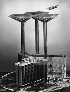 1957: An architect's model of 'Skyport 2000', a futuristic proposal for an airport building to stand in St George's Circus, near Waterloo Station, London in the year 2000. Made for the Glass Age Development Committee and designed by architect James Dartford, the model shows how aircraft could land and take off from a giant platform supported by three glass-clad pillars. These would contain lifts carrying passengers down to a hotel, offices, and parking for private planes and cars.