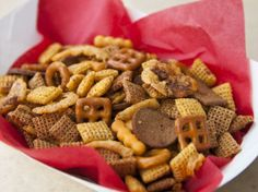 Bacon Blooming Onion Chex Mix - 1 bag (8.75 oz) Chex Mix® traditional snack mix 2 containers (2.8 oz each) French-fried onions 1/2 cup crumbled cooked bacon 1/4 cup butter, melted 1 teaspoon ancho chile powder 3/4 teaspoon ground red pepper (cayenne) 1/2 teaspoon ground cumin