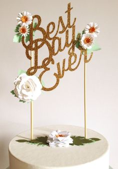 Well, hello there! Welcome to Modern Blooms! Our custom wedding & celebration cake toppers are all handmade-to-order & each design is uniquely