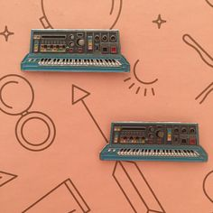"""This is the synth that dreams are made of! This baby blue synth pin will really stand out in your collection. -1.5"""" Soft Enamel Lapel Pin -(2)"""