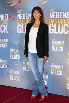 "09/10/2012 - Sophie Marceau - ""Un Bonheur N'Arrive Jamais Seul"" (""Happiness Never Comes Alone"") Germany Photocall - Adlon Hotel - Berlin, Germany - Keywords: full length shot, red high heel shoes, ring, blue denim jeans, white blouse, black jacket, shoulder length wavy brown hair, brunette, stud earrings, jewelry, (Und nebenbei das grosse Glueck) Orientation: Portrait Face Count: 1 - False - Photo Credit: Away! / PR Photos - Contact (1-866-551-7827) - Portrait Face Count: 1"