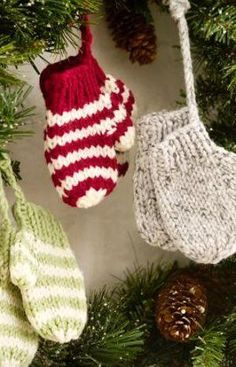 Knit Mitten Ornaments Make this free knitting pattern as a cute decoration for your tree or as gifts. The Knit Mitten Ornaments from Red Heart Yarn are soft and precious, adding a light touch to your Christmas tree.  You could also hang them in other places in the home.  These adorable knit mittens also make great gift tags for loved ones.