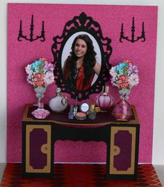 """Card I made using the Cameo """"vanity popup crd"""" file. The mirror shows my Granddaughter, Kelsey. I  took the photo before I put the beads for knobs on the cabinet."""
