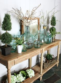 Glass demi johns for Spring in the Entryway - One Thousand Oaks Spring Colors, Spring Flowers, Recycled Glass Bottles, Entrance Ways, Grand Entrance, Small Area Rugs, Spring Home Decor, Home Decor Trends, Cozy House