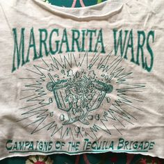 Fun vintage margarita tequila crop top Vintage tshirt crop top featuring dueling margaritas. Pair with high waisted jeans or swim suit cover up. Fits small - large Vintage Tops Crop Tops