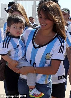 All smiles: Antonella and Thiago look happy to be among the other Argentina fans as they enter the ground