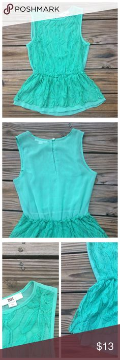 Floral Peplum Too Teal floral lace-like top. Worn once.  Cute peephole back and button closure. Tops Blouses